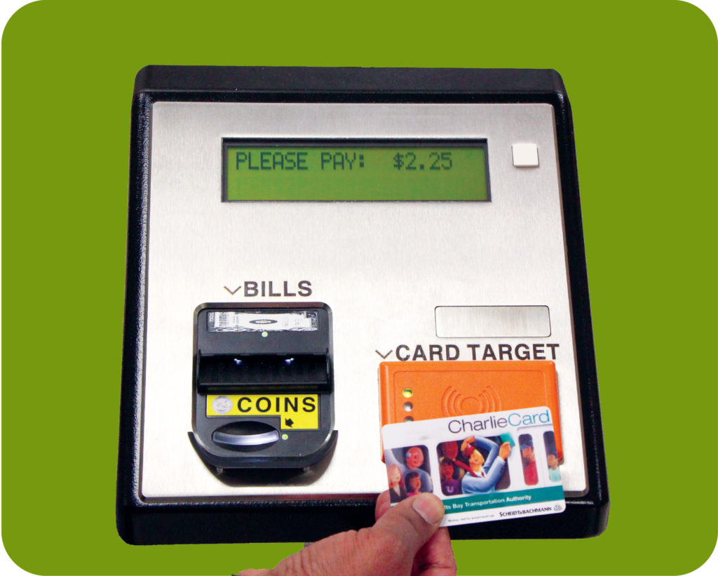 Image of hand swiping CharlieCard over farebox.